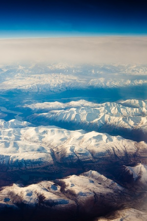 Aerial view of snowcapped mountains in Yukon Territory, Canada.