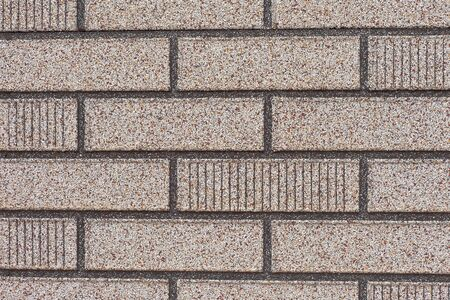 Background texture pattern of exterior wall with fake grey brick siding. Stock Photo - 8579123