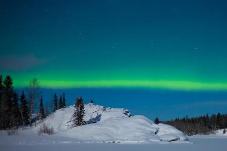 Northern Lights (Aurora borealis) over moon lit snowscape. Stock Photo - 8636506