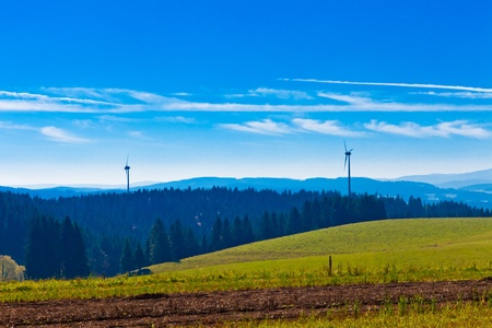 Farmland, forest and wind turbines in Black Forest, rural Germany. Stock Photo - 8836040