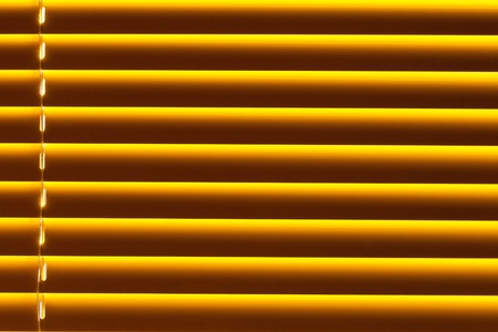 Background pattern texture of yellow plastic blind blocking out bright sunlight shining through window. Stock Photo - 8835974