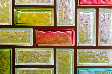 Light distorting colorful glass block window mosaic background pattern texture. photo