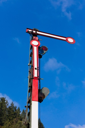 Old railway semaphore against blue sky. Stock Photo - 8837703
