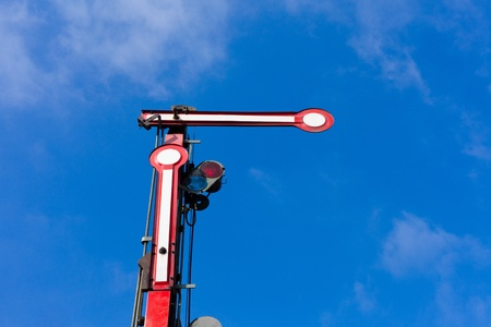 Old railway semaphore against blue sky. Stock Photo - 8837704