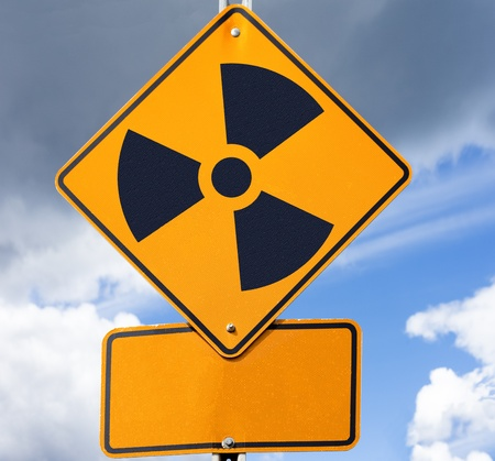 Road sign with radioactivity warning symbol on it and copyspace for your message below. photo