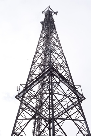 hp: Metal tower with various communication antennas isolated on white.