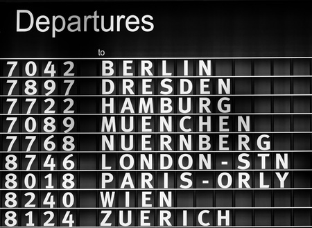 Airport departures information board - air travel background