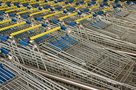 Rows of ready to use shopping carts lined-up in rows for storage. Stock Photo - 9233536