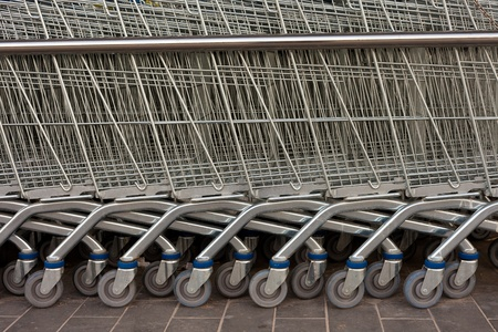 Detail of shiny metal shopping carts stacked in a row. Stock Photo - 9233533