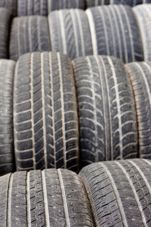 Background texture pattern of old tires for rubber recycling. Shallow DOF photo