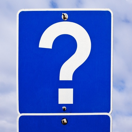 bolted: Blue road sign with just a single white question mark on it. Stock Photo