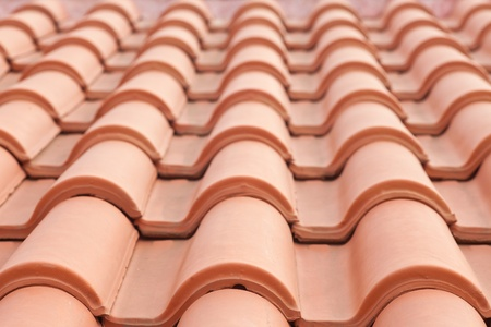 Background texture pattern of red ceramic roof shingles