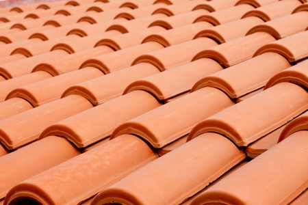 Background texture pattern of red ceramic roof shingles photo