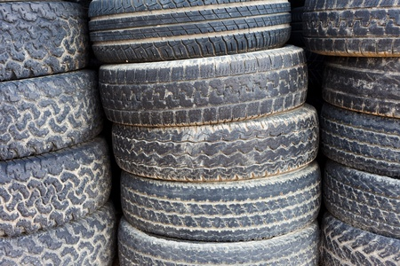 Pile of stacked old tires for rubber recycling. photo