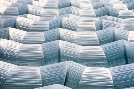 Pattern of endless sea of plastic horticulture greenhouse tunnels for intensive farming of vegetables. photo
