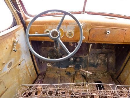 abandoned car: Inside cab view of rusty old junked pick-up truck.
