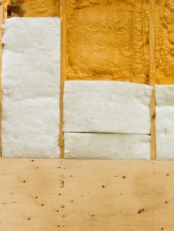 foaming: Different types of building insulation: polyurethane spray foam and fiberglas mats. Stock Photo