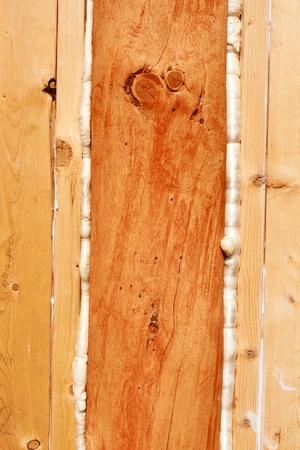 Polyurethane foam seals gaps in wooden frame construction conserving energy. photo