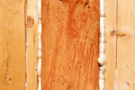 Polyurethane foam seals gaps in wooden frame construction conserving energy. Stockfoto