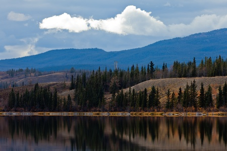 yukon territory: Power transmission line at calm small lake in late fall, Yukon Territory, Canada