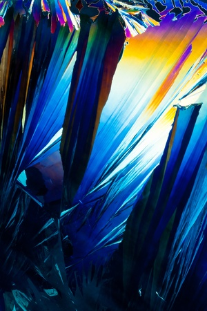 Colorful apearence of crystals of salicylic acid, a drug similar to aspirin used in pain medication, in polarized light