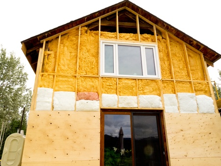Renovation of old house, wall is sprayed with liquid insulating foam before the siding goes on  에디토리얼
