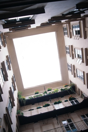 Looking upward from a central courtyard inside an apartment complex in european city Stock Photo - 13451778
