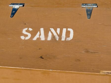 hinged: Hinged lid of painted plywood box providing sand to prevent slippage in winter conditions.
