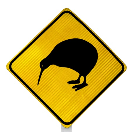 ratite: New Zealand Road Sign  Attention Kiwi Crossing isolated on white background Stock Photo