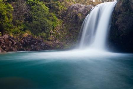 tongariro national park: Water from volcano Mt Ruapehu forms Tawhai Falls in Tongariro National Park, New Zealand Stock Photo