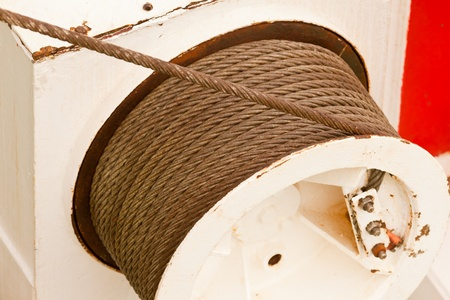 hauling: Drum and metal cable or hawser of a mechanical winch used for hoisting or hauling heavy loads