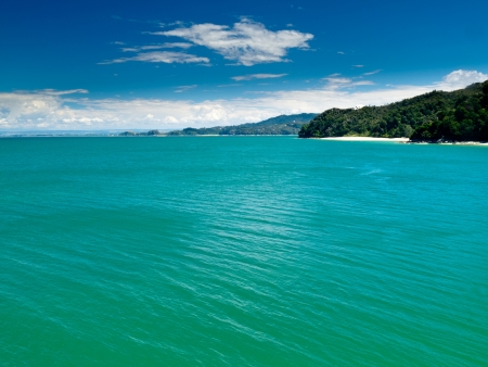 Turquoise waters of Cook Strait off Abel Tasman National Park, South Island, New Zealand Stock Photo - 13629626