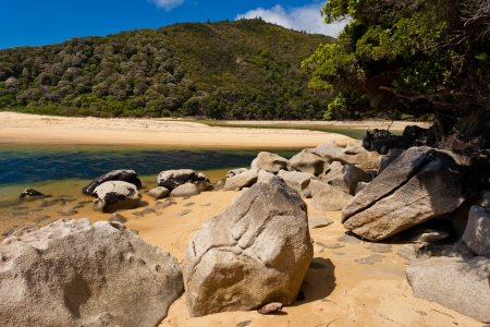 Granite boulders and sandy beach in Abel Tasman National Park, South Island, New Zealand photo