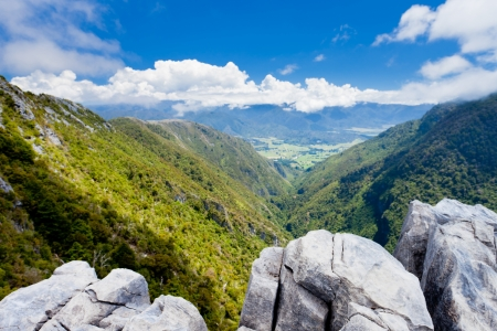 tasman: View from Takaka hill with its limestone outcroppings into Takaka valley, South Island, New Zealand