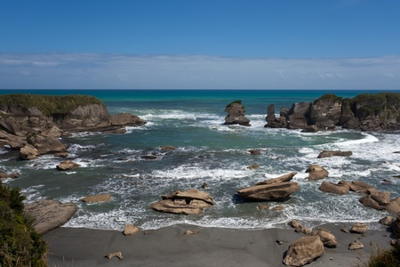 Tasman Sea at rocky West Coast of South Island of New Zealand photo