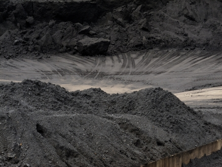 Coal piled to heaps on coal mine train transfer storage site photo