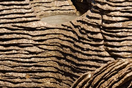 sedimentary: Background texture pattern of eroded cracks between marine sedimentary Pancake Rocks of Punakaiki, New Zealand, close-up Stock Photo