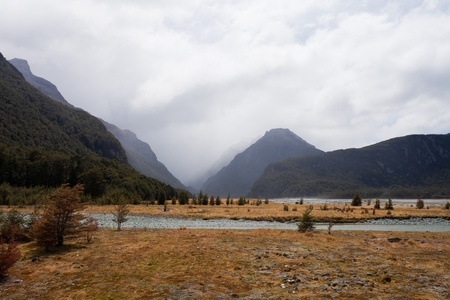 aspiring: Rain shower in Dart River glacial valley, Mt Aspiring National Park, Southern Alps, New Zealand Stock Photo