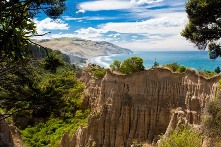 coastal erosion: Badlands erosion formed The Cathedrals clay cliff of Gore Bay, North Canterbury, South Island, New Zealand