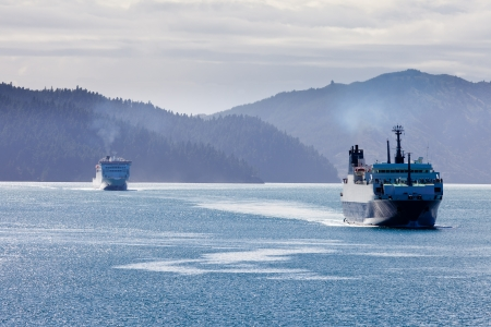 Huge car ferry ships in calm water of Marlborough Sounds, South Island, New Zealand photo