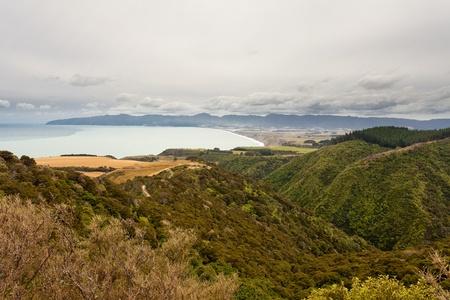 Storm forming over beautiful coastal landscape of Palliser Bay, Nort Island, New Zealand photo