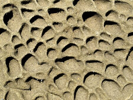 Background texture pattern of pitted eroded sandstone surface exposed to the elements Stock Photo - 13957738