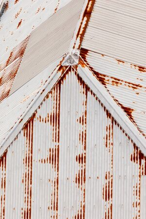 Abstract background texturte pattern of grungy rusting metal roof and galvanised metal clad building photo