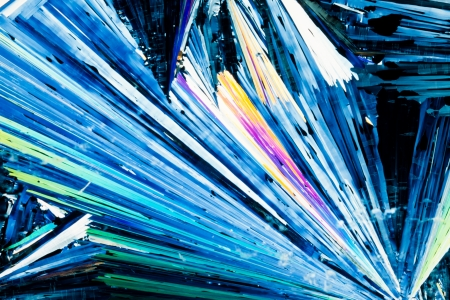 polarization: Colorful apearence of crystals of benzoic acid, a food preserving additive, in polarized light.