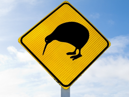 ratite: New Zealand Road Sign, Attention Kiwi Crossing against a cloudy blue sky