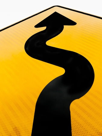 curved road: Wavy arrow on road sign pointing upward in a concept of achievement, advancement and success Stock Photo