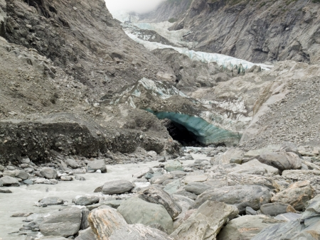 icescape: Large alpine glacier icefield melting rapidly due to global warming exposing bare rock face