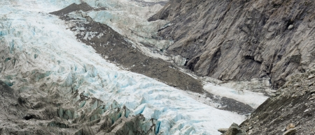icefield: Large alpine glacier icefield melting rapidly due to global warming exposing bare rock face