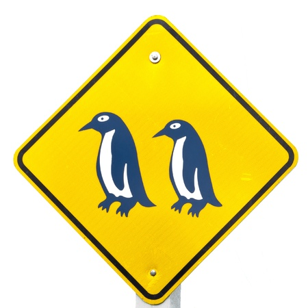new rules: New Zealand Road Sign, Attention Blue Penguin Crossing isolated on white background Stock Photo