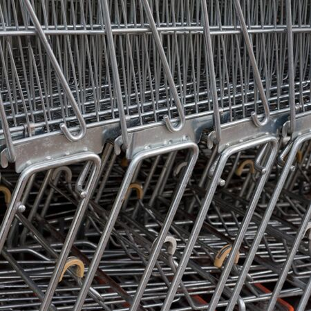 Detail of shiny metal shopping carts stacked in a row. photo